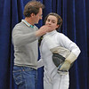 Julian Moiseiwitsch congratulates his daughter after the gold medal bout in Division II Women's Epee.  Nina lost 15-9 to place 2nd out of 106 entries.
