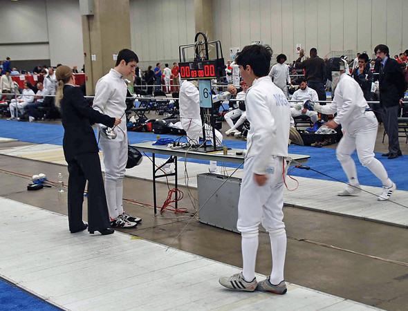 Danny Wiggins (right) before the start of his DE bout in the Division II Men's Epee.