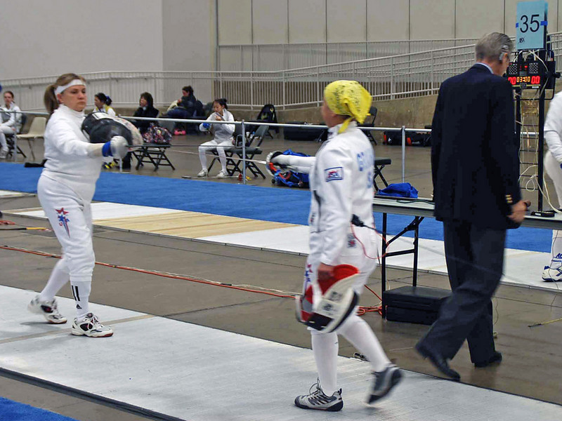 Bettie Graham checks guards with Diane Kallus in the Veteran-60 Women's Epee.