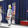 Bettie Graham (right) checks vests in the semi-final bout of Veteran-60 Women's Foil.