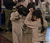 Elizabeth Wiggins checks guards at the Y10 Mixed Epee.