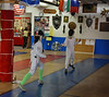 Jared Heath (right) in the Y14 Mixed Epee.