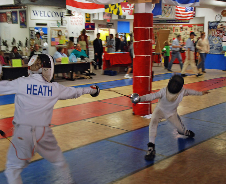 Jared Heath (left) in Y14 Mixed Epee.