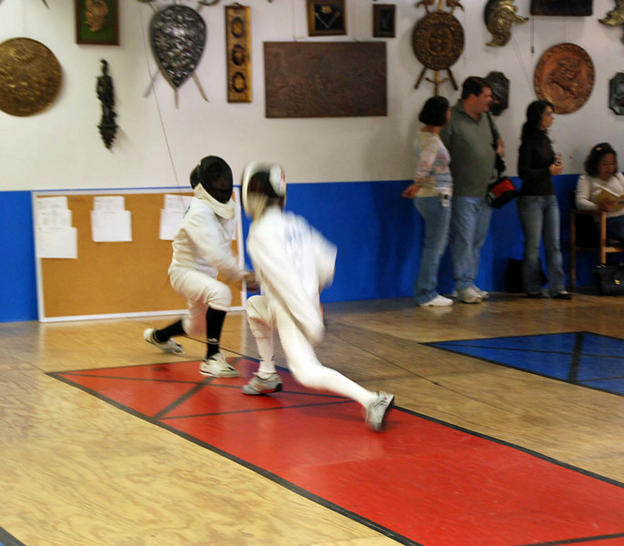 Daniel Wiggins (right) in Y14 Mixed Epee.