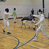 Edward Stewart (right) in the Y14 Mixed Epee.
