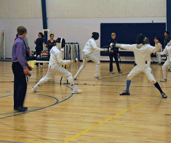 Edward Stewart (left) in the Y14 Mixed Epee.