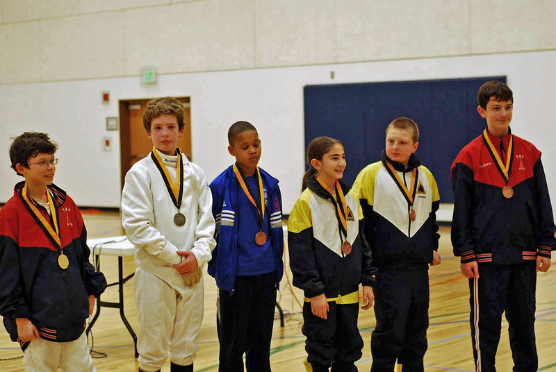 The top finalists in the Y12 Mixed Epee, from left: Victor Teelucksingh (1st), Ellis Driscoll (2nd), Max Robinson (3rd), Elizabeth Wiggins (3rd), Cameron Sullivan (5th), and Jack Elliott (6th).  Only 6 medals were awarded.  (Photo by Jeff Hayden.)