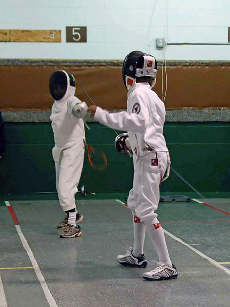 Levi Freedman (far side) fencing in the Y12 Mixed Epee.