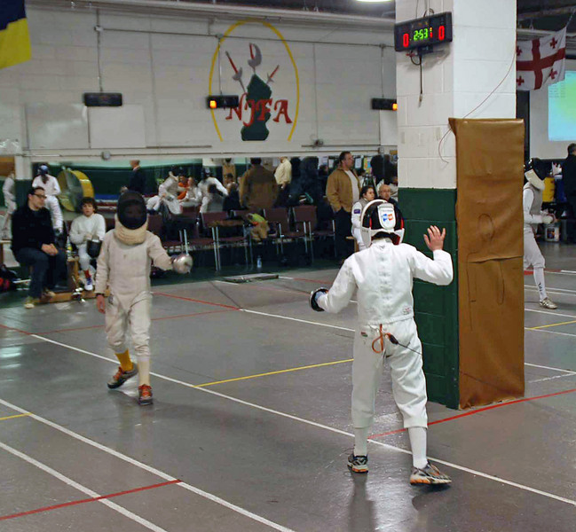 Levi Freedman (right) fencing in the Y10 Men's Epee.