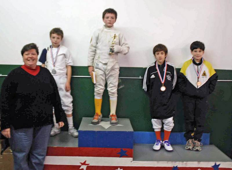 The finalists in the Y10 Men's Epee: (from left) Elias Cole (2nd), Will Eschenbach (1st), Emmitt Sklar (3rd), Levi Freedman (3rd).  Foreground: Barbara Lynch.