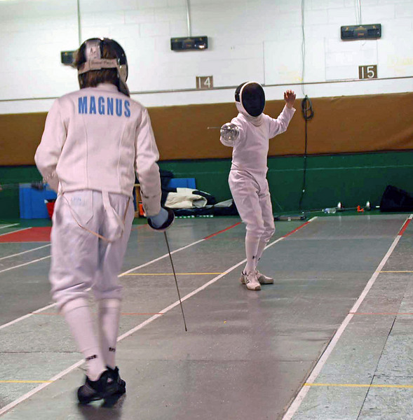 Raphael Hviding (on the far side of the strip) in the Y14 Men's Epee.