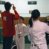 The referee checks the tip of Levi Freedman's epee in the Y12 Mixed Epee.