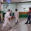 Levi Freedman (left) fencing in the Y12 Mixed Epee.