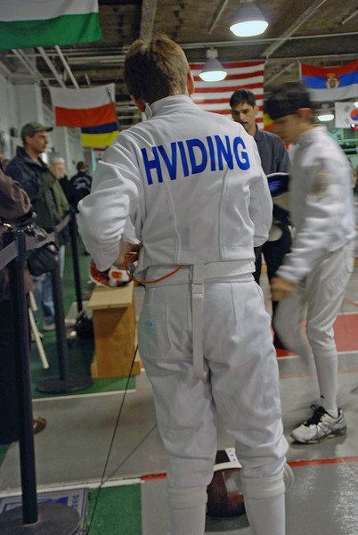 Raphael Hviding hooks up for his first bout in the Y14 Men's Epee.
