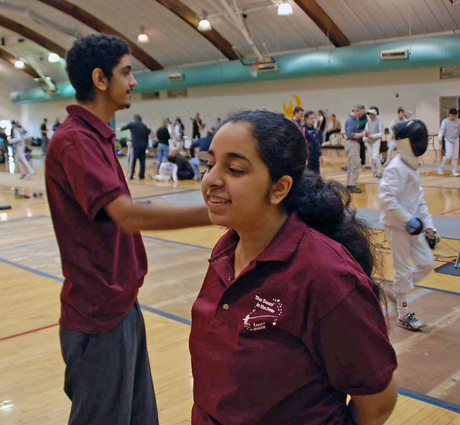 Yasser Mahmoud and his sister, Taysir Mahmoud, a fencer at Wellesley College, were refereeing at the NH Super Youth Circuit.
