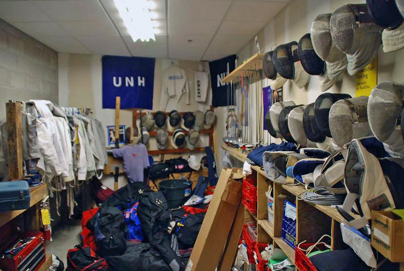 The University of New Hampshire Fencing Team storage closet.