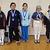 The finalists in the Y10 Women's Epee.  From right: Elizabeth Wiggins (1st), Adelle Berdichevsky (2nd), Caroline Mesinger (3rd), Camille Simmons (3rd), Julianna Kinslow (5th).