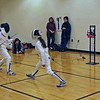 Lizzie Wiggins (right) in the Y10 Women's Epee.