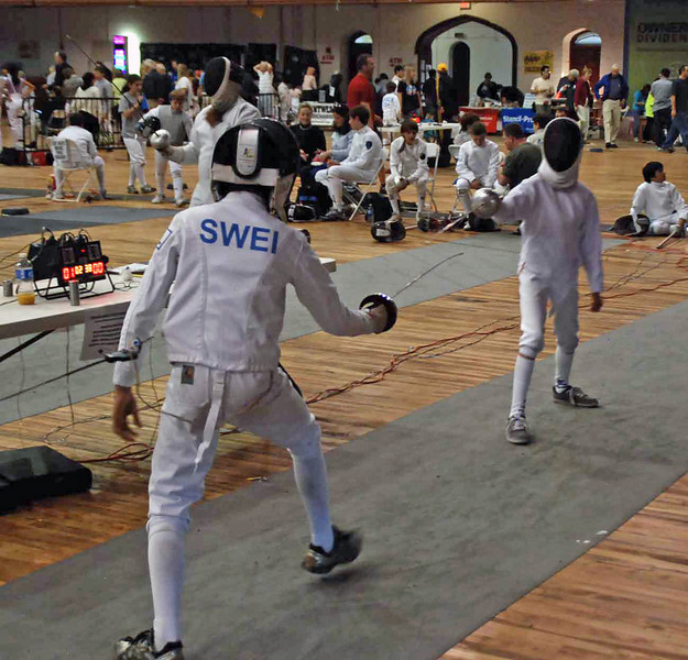 Romain Hufbauer (right) in Y14 Men's Epee.