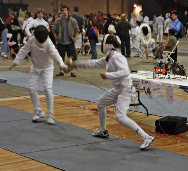 Raphael Hviding (right) in Y14 Men's Epee.