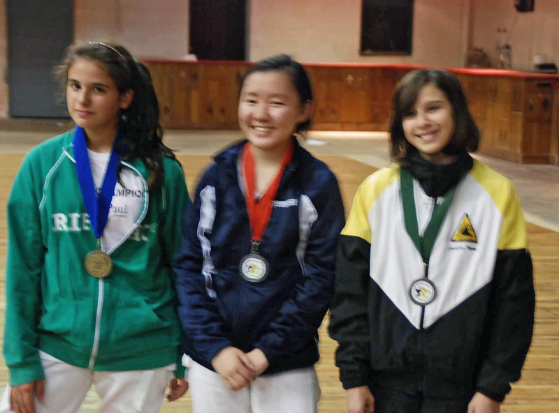 The medalists at the award ceremony for Y14 Women's Epee.  From left: Dominique Tannous (1st), Amy Tong (2nd), and Julia Smith (8th).