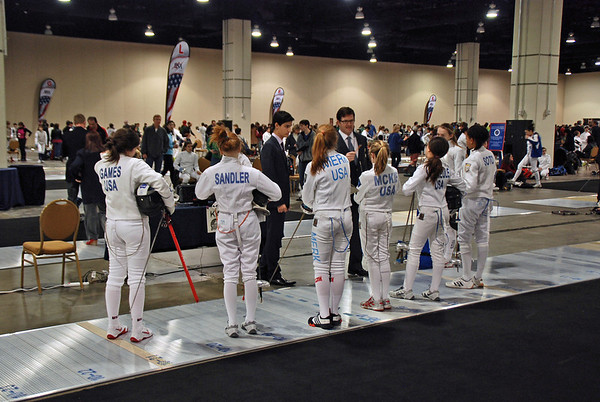 Alexis Sandler gathers with her pool at the start of the Cadet Women's Epee.