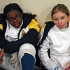 Mikaelle Mathurin (left) and Elise King wait for the Youth-12 Women's Epee event to begin.