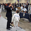 Referee Jim Adams checks the epee of Henry Tucker in the Youth-10 Men's Epee.