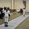 Mikaelle Mathurin (left) in the Youth-12 Women's Epee.