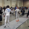 Elise King (right) tests guards at the beginning of the Youth-12 Women's Epee.
