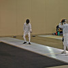 Lucas Partridge (left) in the Cadet Men' s Epee.