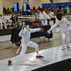James Passmore (left) in the Youth-12 Men's Epee.