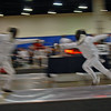 Lucas Partridge (left) in the Youth-14 Men's Epee.