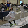 Anton Jordan (left) in the Youth-12 Men's Epee.