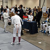 Madeleine Parker adjusts her equpment before a bout in the Youth-14 Women's Epee.