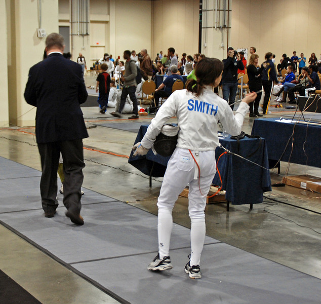 Julia Smith checks to make sure she has two screws in her epee tip before a direct elimination bout in Youth-14 Women's Epee.