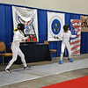 Juila Smith (left) competing in the gold medal bout of the Cadet Women's Epee.
