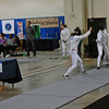 Julia Smith (left) scores on her opponent in the Youth-14 Women's Epee.