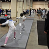 Elizabeth Wiggins scores a touch in the Youth-14 Women's Epee.