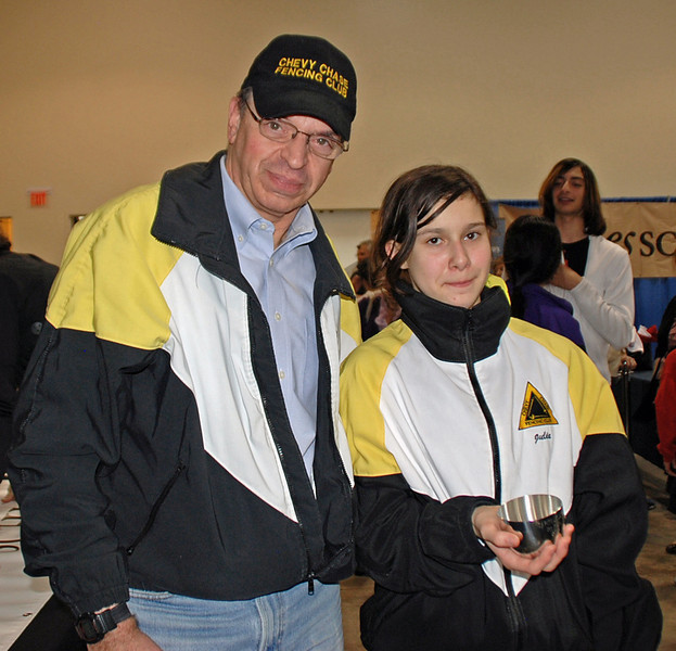 Fencing Master Raymond Finkleman with gold medalist Julia Smith.