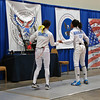 Juila Smith shakes hands with her opponent after winning the Cadet Women's Epee.