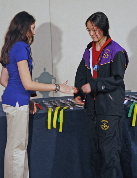 Annie Yang receives her 3rd place medal in the Cadet Women's Epee.