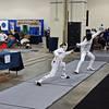 Simon Hardy (left) in the Youth-14 Men's Epee.