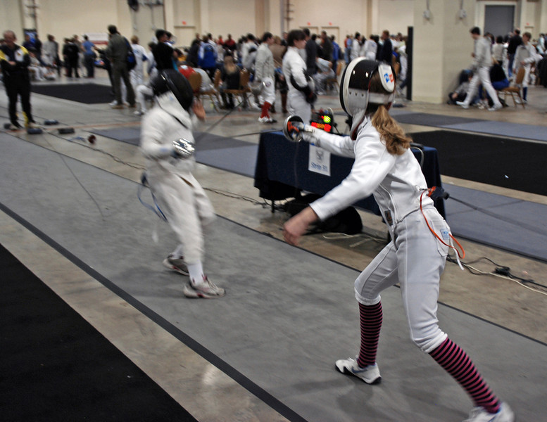 Linden Hill (right) scores at touch in the Youth-12 Women's Epee.