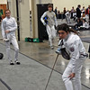 Juliana Bain (left) preparing for her bout in the Youth-14 Women's Epee.