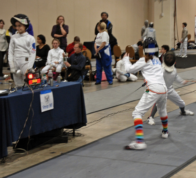 Emma Scala scores a touch in the Youth-12 Women's Epee.