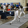 Simon Hardy (left) scores a touch in the Youth-14 Men's Epee.