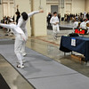Alexander Cohen (right) scores in the Youth-14 Men's Epee.