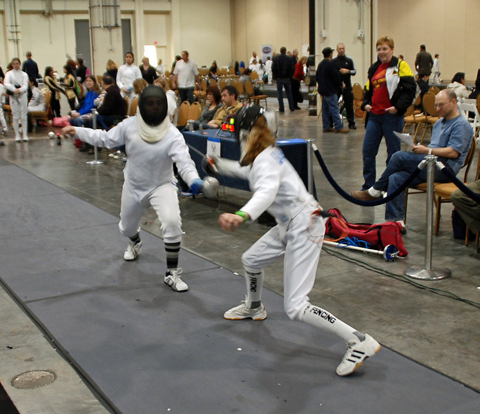 Alexis Sandler (right) scores a touch on her opponent in the Youth-14 Women's Epee.