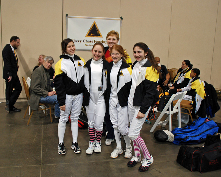 Some of our youth-14 women's epee fencers pose with Coach Jean Finkleman.  From left: Julia Smith, Madeleine Parker, Alexis Sandler and Elizabeth Wiggins.